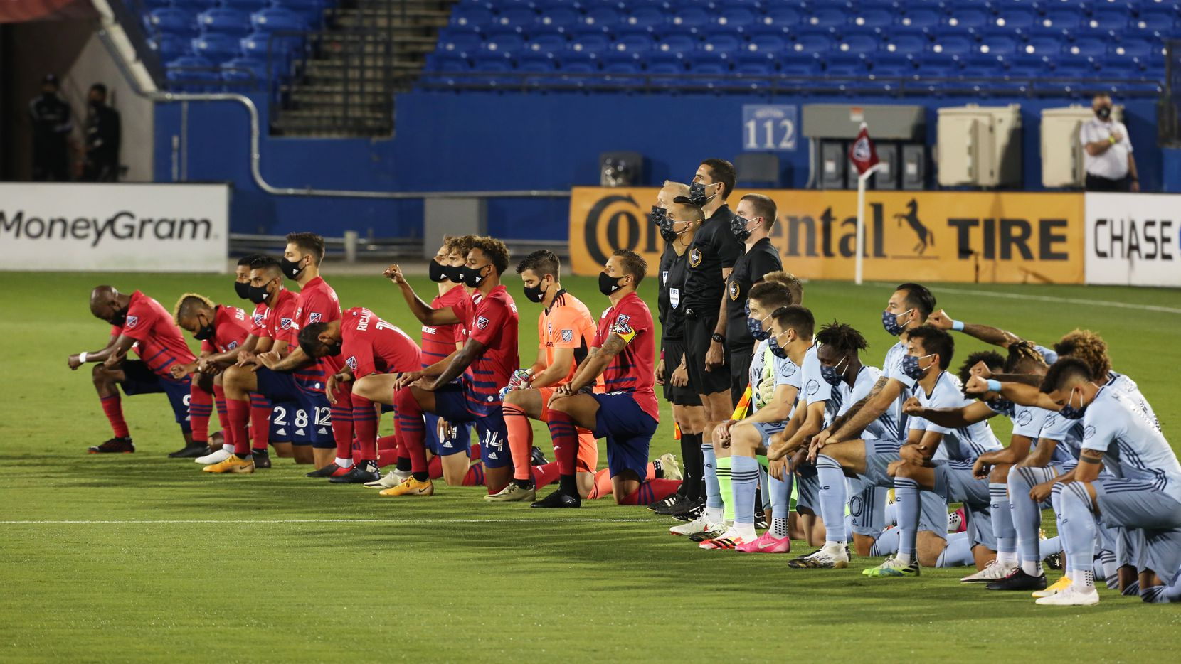 FRISCO, TX - OCTOBER 3: Players of FC Dallas and Sporting Kansas City teams  kneel during the national anthem prior the MLS Game between FC Dallas and Columbus Crew SC at Toyota Stadium on October 3, 2020 in Frisco, Texas.