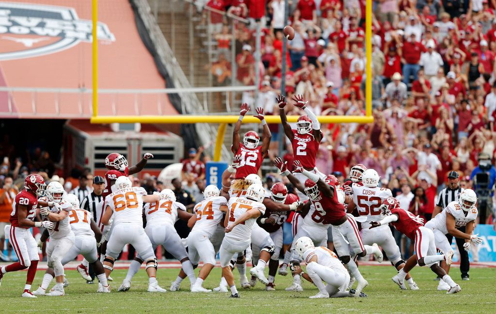 Texas Longhorns place kicker Cameron Dicker (17) kicks the game winning field goal as Oklahoma Sooners defends during the second half of play at the Cotton Bowl in Dallas on Saturday, October 6, 2018. Texas Longhorns defeated Oklahoma Sooners 48-45. (Vernon Bryant/The Dallas Morning News)
