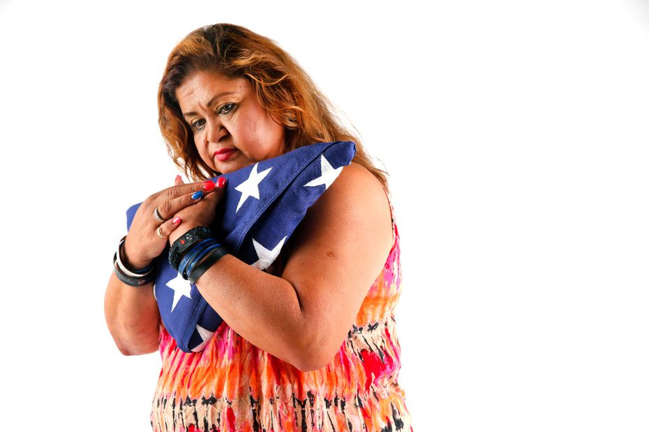 Photographer Tom Fox was honored for images including this one of Valerie Zamarripa, mother of slain Dallas police Officer Patrick Zamarripa. She was photographed in the newspaper's studio with the U.S. flag that was presented to her during her son's funeral at Dallas-Fort Worth National Cemetery.