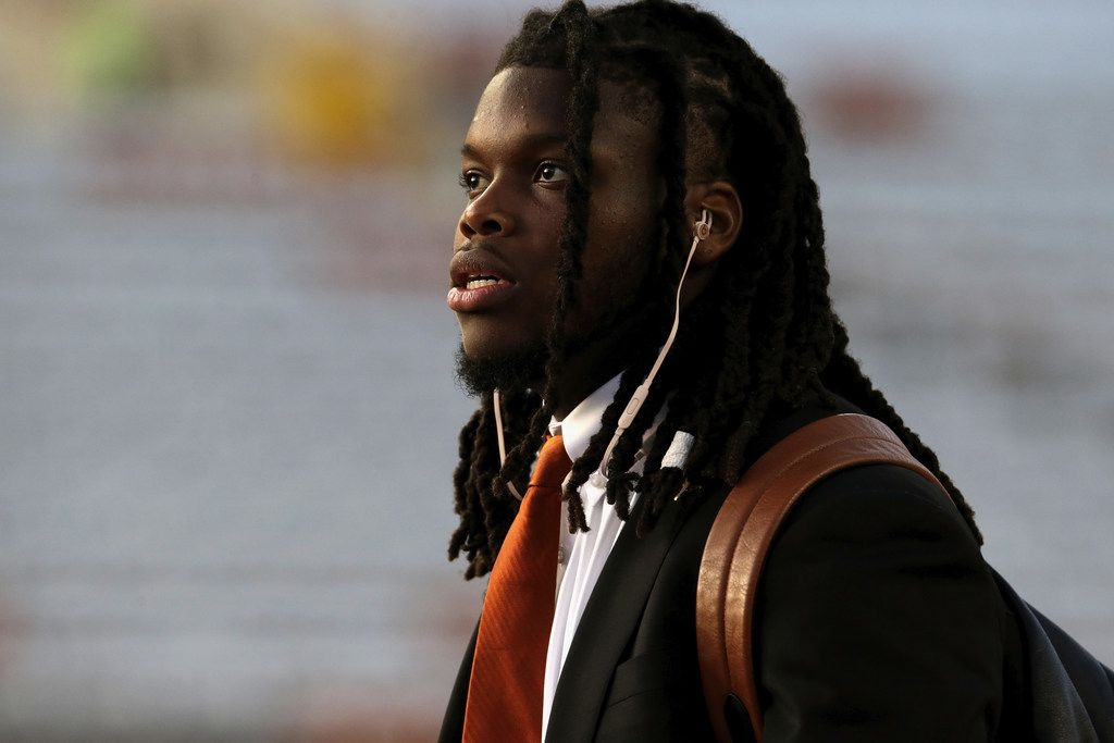 AUSTIN, TX - NOVEMBER 24:  Malik Jefferson #46 of the Texas Longhorns arrives at the stadium before the game against the Texas Tech Red Raiders at Darrell K Royal-Texas Memorial Stadium on November 24, 2017 in Austin, Texas.  (Photo by Tim Warner/Getty Images)