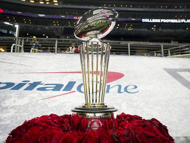 The game championship trophy is seen on the sideline before the Rose Bowl NCAA college football playoff semifinal between Alabama and Notre Dame at AT&T Stadium on Friday, Jan. 1, 2021, in Arlington. (Smiley N. Pool/The Dallas Morning News)