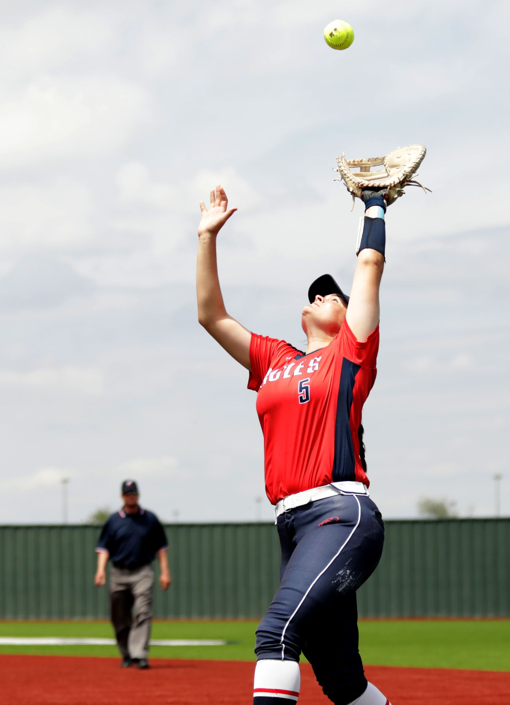 Allen High School player #5, Brooklyn Purtell, takes out a Flower Mound High School hitter during a softball game at Allen High School in Allen, TX, on May 15, 2021. (Jason Janik/Special Contributor)