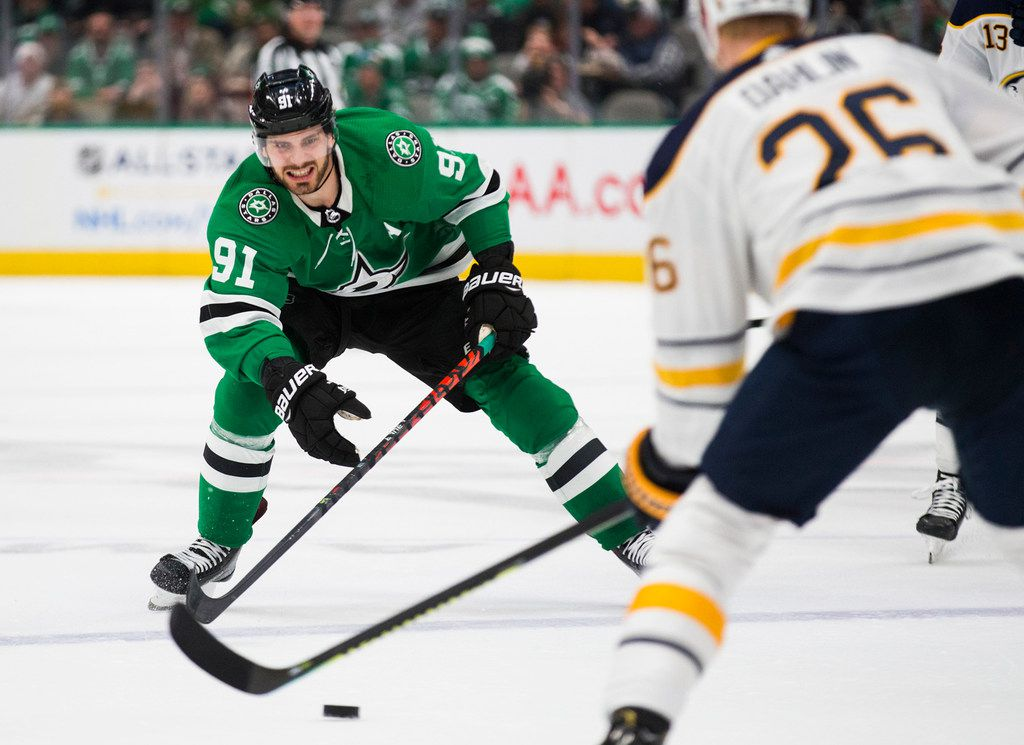 The Dallas Stars' Tyler Seguin (91) looks to get the puck from the Buffalo Sabres' Rasmus Dahlin (26) during the first period on Thursday, Jan. 16, 2020, at the American Airlines Center in Dallas.