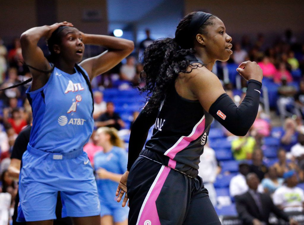 Dallas Wings guard Arike Ogunbowale (24, right) reacts after scoring and being fouled against Atlanta Dream center Elizabeth Williams (1) during the fourth quarter at College Park Center in Arlington, Texas, Sunday, August 25, 2019. Despite their comeback in the fourth quarter, the Wings fell to the Dream, 77-73. (Tom Fox/The Dallas Morning News)