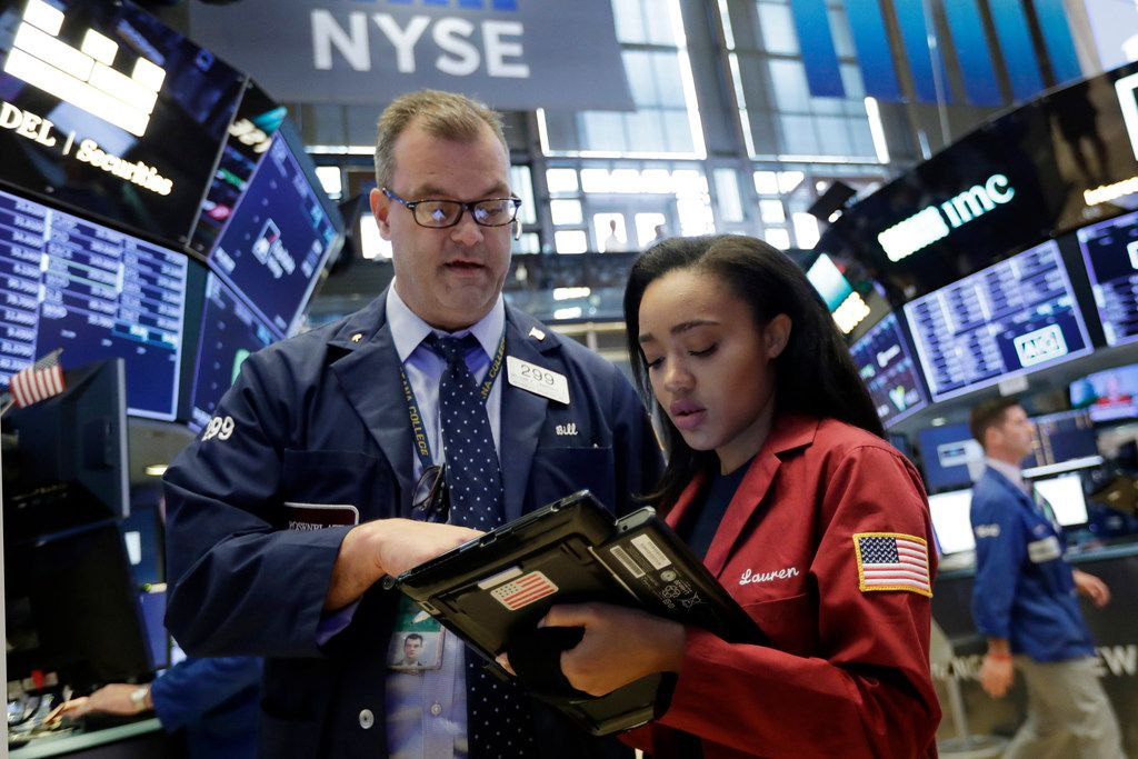 Traders William Lawrence and Lauren Simmons work on the floor of the New York Stock Exchange, Wednesday, July 18, 2018.