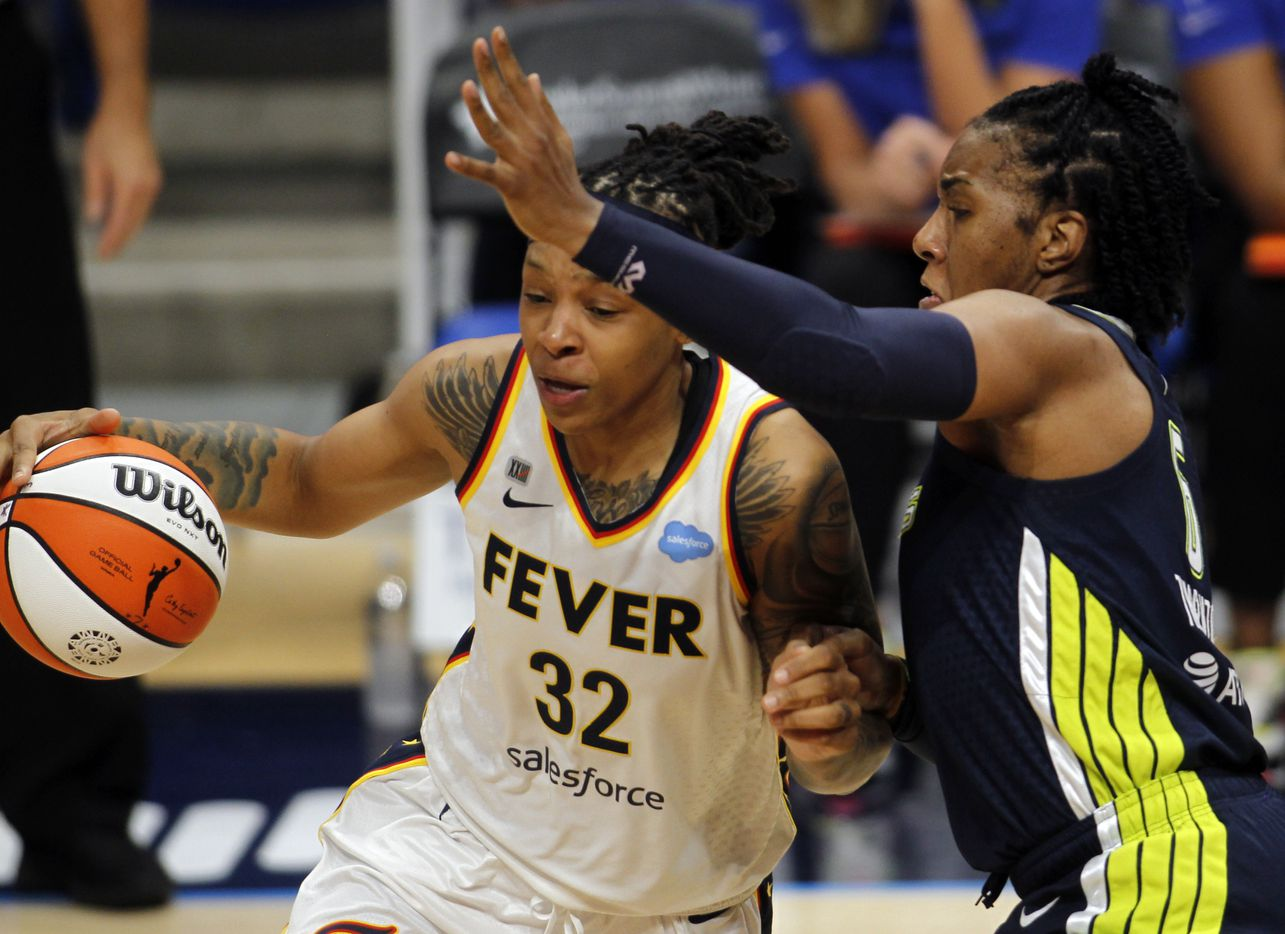 Indiana Fever forward Emma Cannon (32), left, drives against the defense of Dallas Wings forward Kayla Thornton (6) during first half action. The fever defeated the Wings 83-81. The Dallas Wings hosted the Indiana Fever for their WNBA game held at College Park Center on the campus of UT-Arlington on August 20, 2021. (Steve Hamm/ Special Contributor)