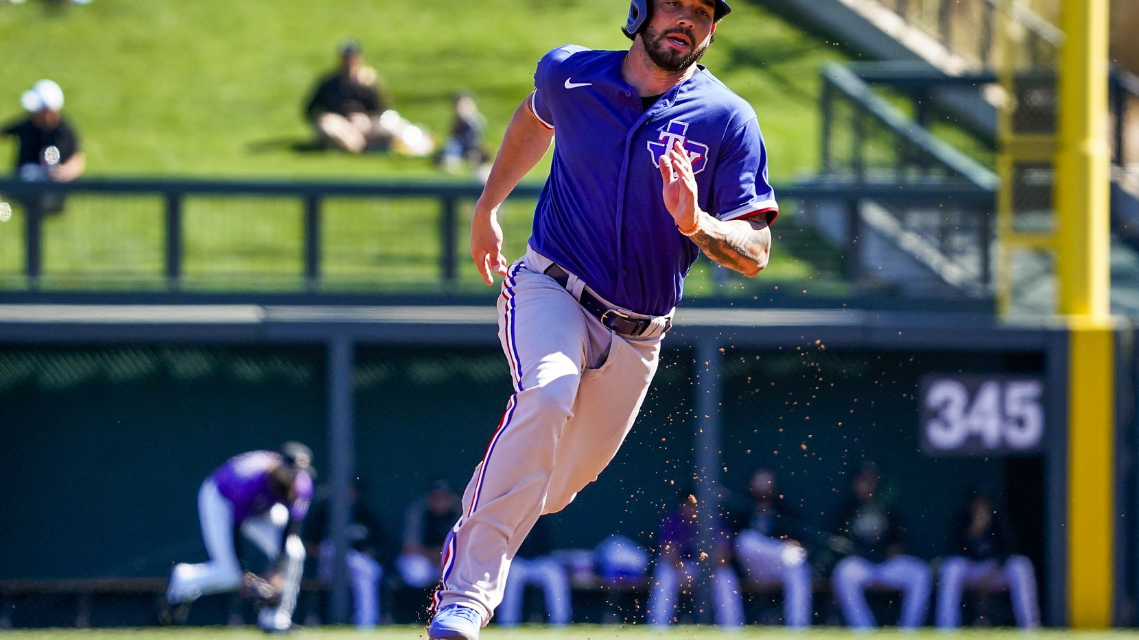 Texas Rangers catcher Blake Swihart rounds second base and heads for third to advance on a single by outfielder Danny Santana during the third inning of a spring training game against the Colorado Rockies at Salt River Fields at Talking Stick on Wednesday, Feb. 26, 2020, in Scottsdale, Ariz.