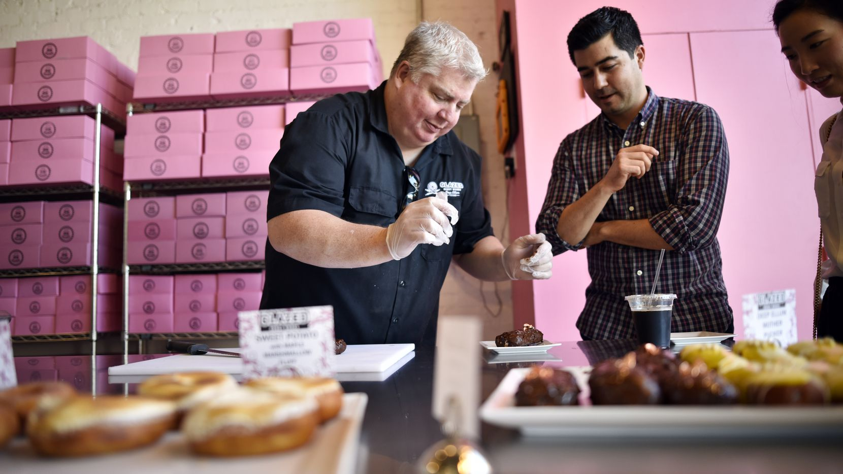 Owner Darren Cameron, left, closed Glazed Donut Works in 2018. He's back with pop-ups in 2020, teasing customers with new recipes.