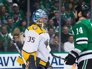 Dallas Stars left wing Jamie Benn (14) tries to distract Nashville Predators goaltender Pekka Rinne (35) at the goal during the first period of Game 6 of the first round of Stanley Cup Playoffs between the Dallas Stars and the Nashville Predators on Monday, April 22, 2019 at American Airlines Center.