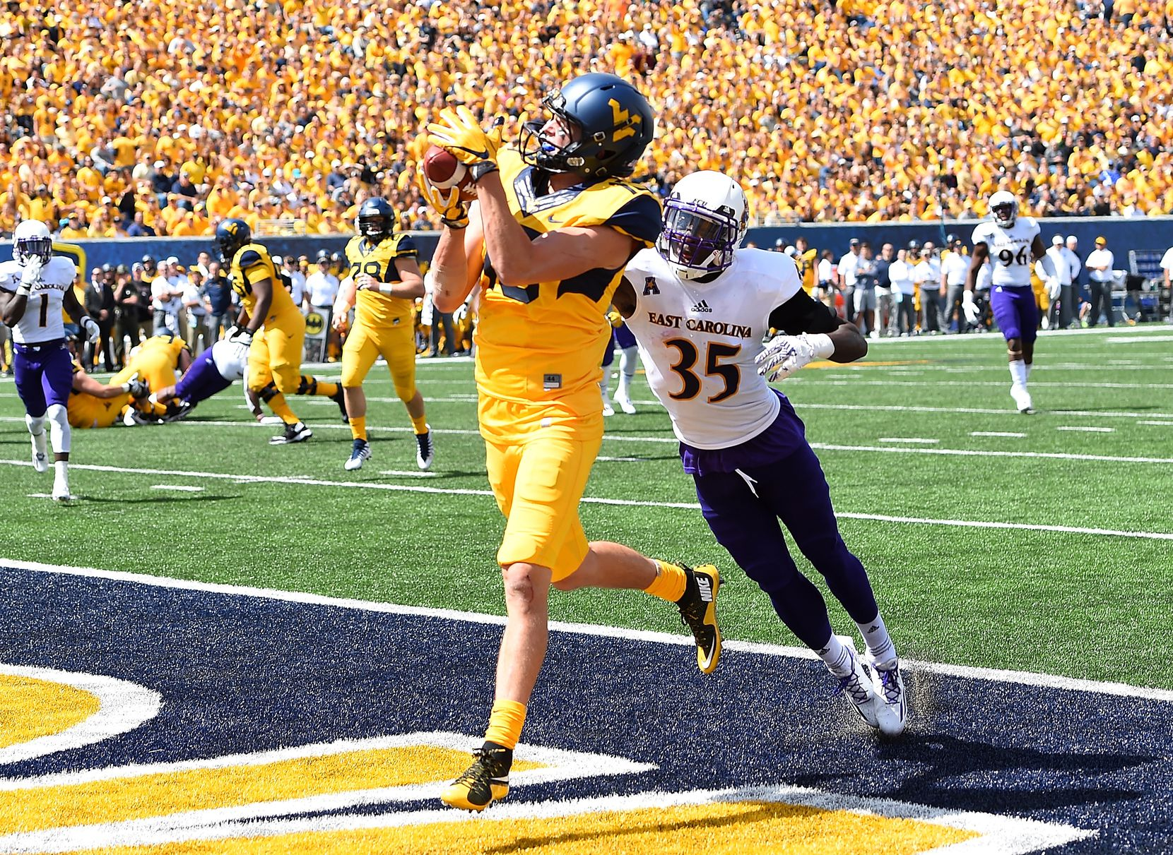 FILE - West Virginia's David Sills V (13) makes a touchdown catch in front of East Carolina's Chris Love (35) during the second quarter of a game at Mountaineer Field on Sept. 9, 2017, in Morgantown, W.Va. (Photo by Joe Sargent/Getty Images)