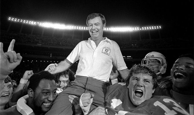 University of Texas Football coach Darrell Royal is carried from the football field following his final game. The Longhorns beat Arkansas 29-12. The University of Texas says the former football coach, who won two national championships and a share of a third, has died. He was 88. UT spokesman Nick Voinis on Nov. 7, 2012 confirmed Royal's death in Austin.