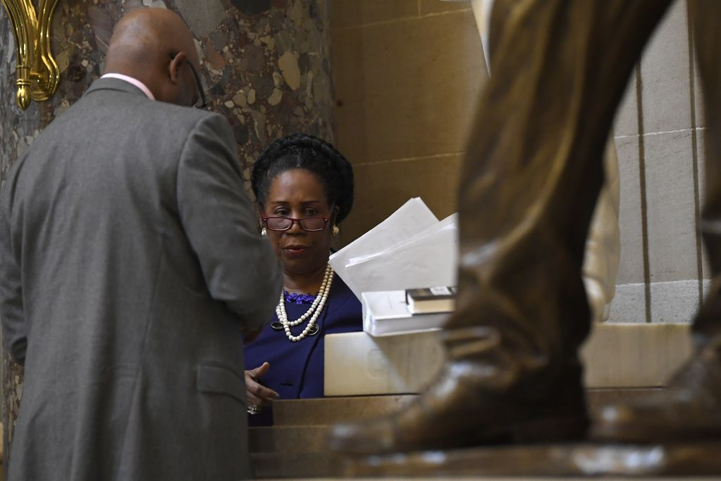 Rep. Sheila Jackson Lee, D-Texas, goes over notes while standing in Statuary Hall on Capitol Hill in Washington on, Dec. 18, 2019.