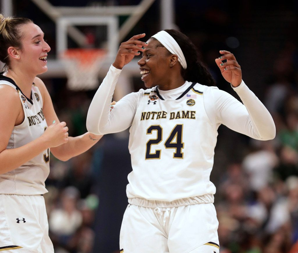 Notre Dame guard Arike Ogunbowale (24) and guard Marina Mabrey celebrate after Notre Dame defeated Connecticut 81-76 during a Final Four semifinal of the NCAA women's college basketball tournament Friday, April 5, 2019, in Tampa, Fla.