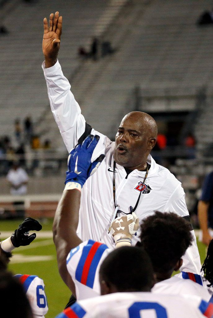 Duncanville head coach Reginald Samples gathers his players together for a postgame huddle after defeating Lancaster, 24-3, at Beverly D. Humphrey Tiger Stadium in Lancaster Texas, Friday, August 30, 2019. (Tom Fox/The Dallas Morning News)
