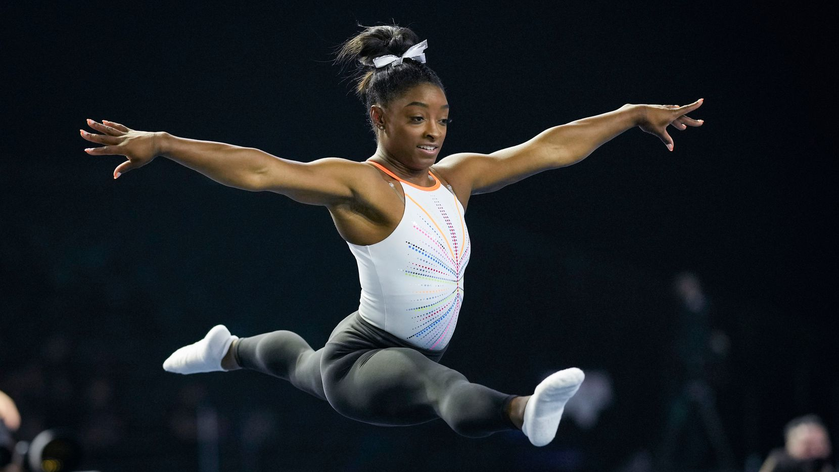Simone Biles warms up before competing in the U.S. Classic gymnastics competition in Indianapolis, Saturday, May 22, 2021. (AP Photo/AJ Mast)