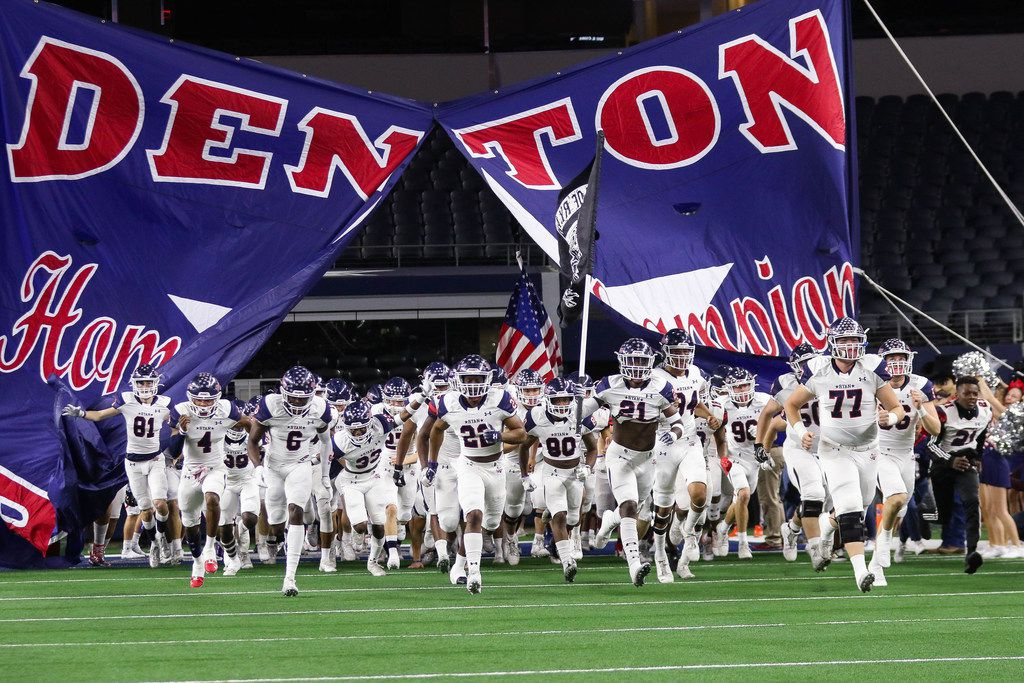 Denton Ryan runs out before a Class 5A Division I state championship game against Alvin Shadow Creek at the AT&T Stadium in Arlington, on Friday, December 20, 2019. Shadow Creek leads at halftime 14-8. (Juan Figueroa/The Dallas Morning News)