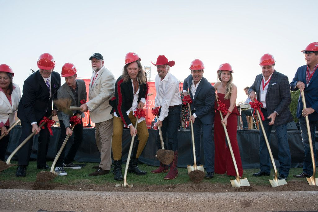 Richard Branson center and others toss first during the ground breaking for his Virgin Hotel in the Design District on Monday, Oct. 17, 2016   (Rex C. Curry/Special Contributor)