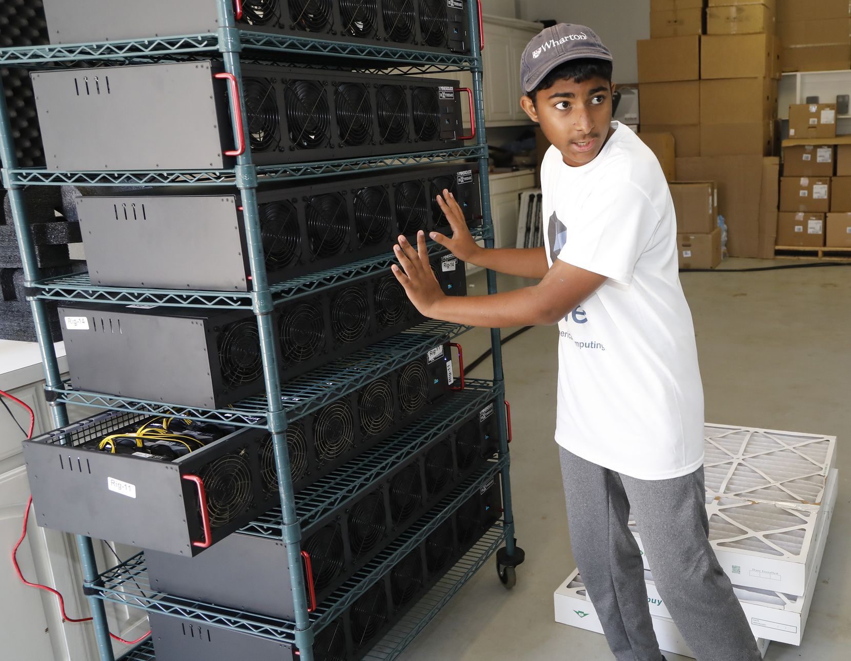 Frisco resident Ishaan Thakur, 14, expains how he is mining cryptocurrency with computers in his garage to make money for college.