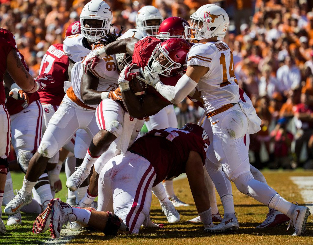 Oklahoma Sooners running back Samaje Perine (32) falls into the end zone for a touchdown during the first quarter of the 2016 AT&T Red River Showdown between the Texas Longhorns and the Oklahoma Sooners on Saturday, October 8, 2016 at the Cotton Bowl at Fair Park in Dallas. (Ashley Landis/The Dallas Morning News)