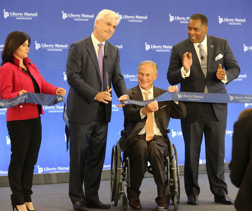 Liberty Mutual Chief Talent and Enterprise Services Officer Melanie Foley, Liberty Mutual Insurance Chairman and CEO David H. Long, Texas Governor Greg Abbott and Plano Mayor Harry LaRosiliere, left to right, cut the ribbon during the ceremonial opening of Liberty Mutual's new campus in Plano on Wednesday, November 29, 2017. (Louis DeLuca/The Dallas Morning News)