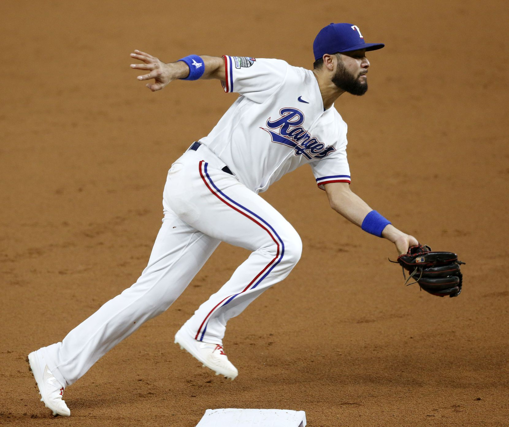 Texas Rangers third baseman Isiah Kiner-Falefa (9) scoops up a grounder by Los Angeles Angels batter Andrelton Simmons (2) and makes the out at first during the third inning at Globe Life Field in Arlington, Texas, Tuesday, September 8, 2020. (Tom Fox/The Dallas Morning News)