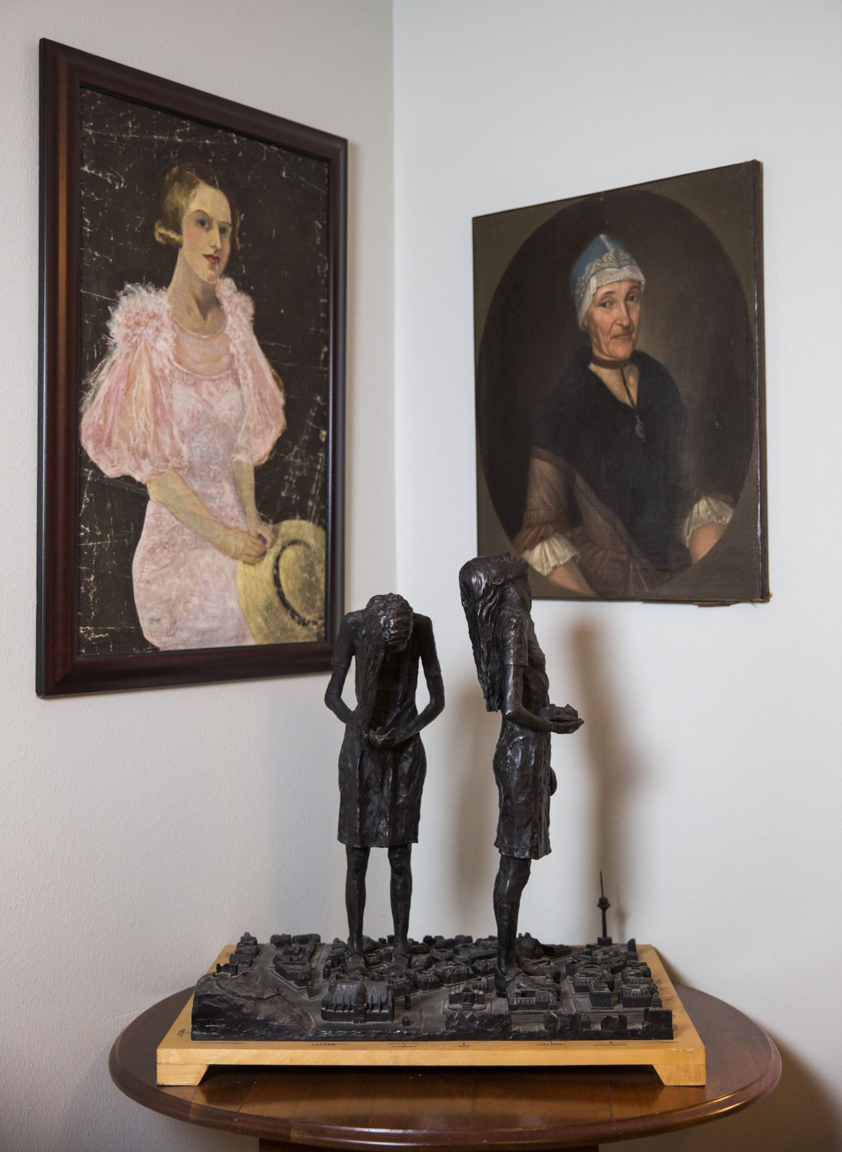Painted portraits and a sculpture are displayed in the Austin home of authors Elizabeth McCracken and Edward Carey.