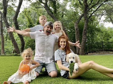 Mike and Jenn Todryk are shown with their three children and dog. The family is a frequent topic on Jenn's blog, The Rambling Redhead, and her Instagram account.