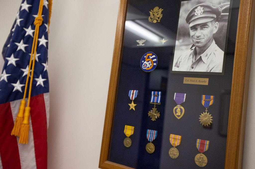 A commemorative display for Medal of Honor recipient and Arlington High School graduate Neel Kearby is seen inside of Arlington City Hall on Wednesday, July 24, 2019. Kearby was an Army Air Force colonel and pilot who died in World War II. The City of Arlington is one of two finalists for a proposed site to build a new Medal of Honor museum.