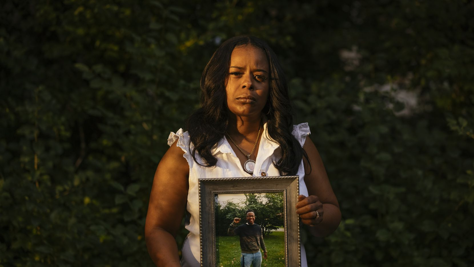 Rafiah Maxie holds a photo of her son, Jamal Clay, outside her home on July 9, 2021, in Olympia Fields, Illinois. Maxie s son, Clay, died by suicide in May 2020. Research shows that while suicide rates have dropped for white Americans in recent years, it is a growing crisis for communities of color.