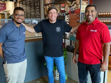 Todd Graves, founder of Raising Cane's Chicken Fingers (center), visited 10 restaurants on the TV show 'Restaurant Recovery.' One of the restaurants was Dallas' Smokey John's Bar-B-Que & Home Cooking, co-owned by brothers Brent Reaves (left) and Juan Reaves.