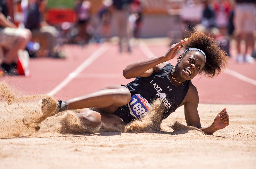 Mansfield Lake Ridge's Jasmine Moore reacts after completing a jump in the Girls 5A Triple Jump during the UIL state track meet at the Mike A. Myers Stadium, at the University of Texas on May 11, 2018 in Austin, Texas. This jump ended up breaking the meet and state record in Triple Jump. (Thao Nguyen/Special Contributor)