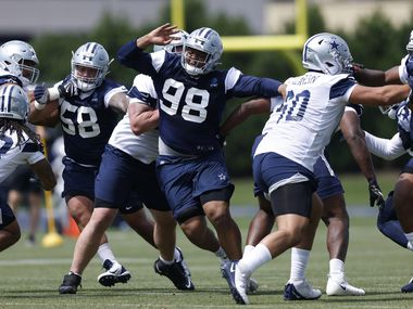 Dallas Cowboys rookie defensive tackle Quinton Bohanna (98) gets through the offensive line during team drills at rookie minicamp at the The Star in Frisco, Texas, Saturday, May 15, 2021. (Tom Fox/The Dallas Morning News)
