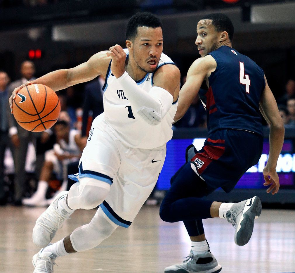 FILE - In this Nov. 29, 2017, file photo, Villanova guard Jalen Brunson (1) drives past Pennsylvania guard Darnell Foreman (4) during the first half of an NCAA college basketball game,  in Villanova, Pa.  Brunson, one of the prospects for the NBA Draft,  was The Associated Press national player of the year who led Villanova to a second national championship in three seasons. (AP Photo/Laurence Kesterson, File)