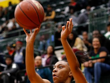 DeSoto's Ariyanna Hines (24) puts up a long range shot during second half action against South Grand Prairie. The two teams played their District 7-6A girls basketball game at DeSoto High School in DeSoto on January 21, 2020. (Steve Hamm/ Special Contributor)