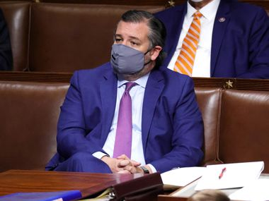 Sen. Ted Cruz sits in the House Chamber during a joint session of Congress on Jan. 6, 2021, after protesters stormed the Capitol and disrupted a joint session to ratify President-elect Joe Biden's 306-232 Electoral College win over President Donald Trump.