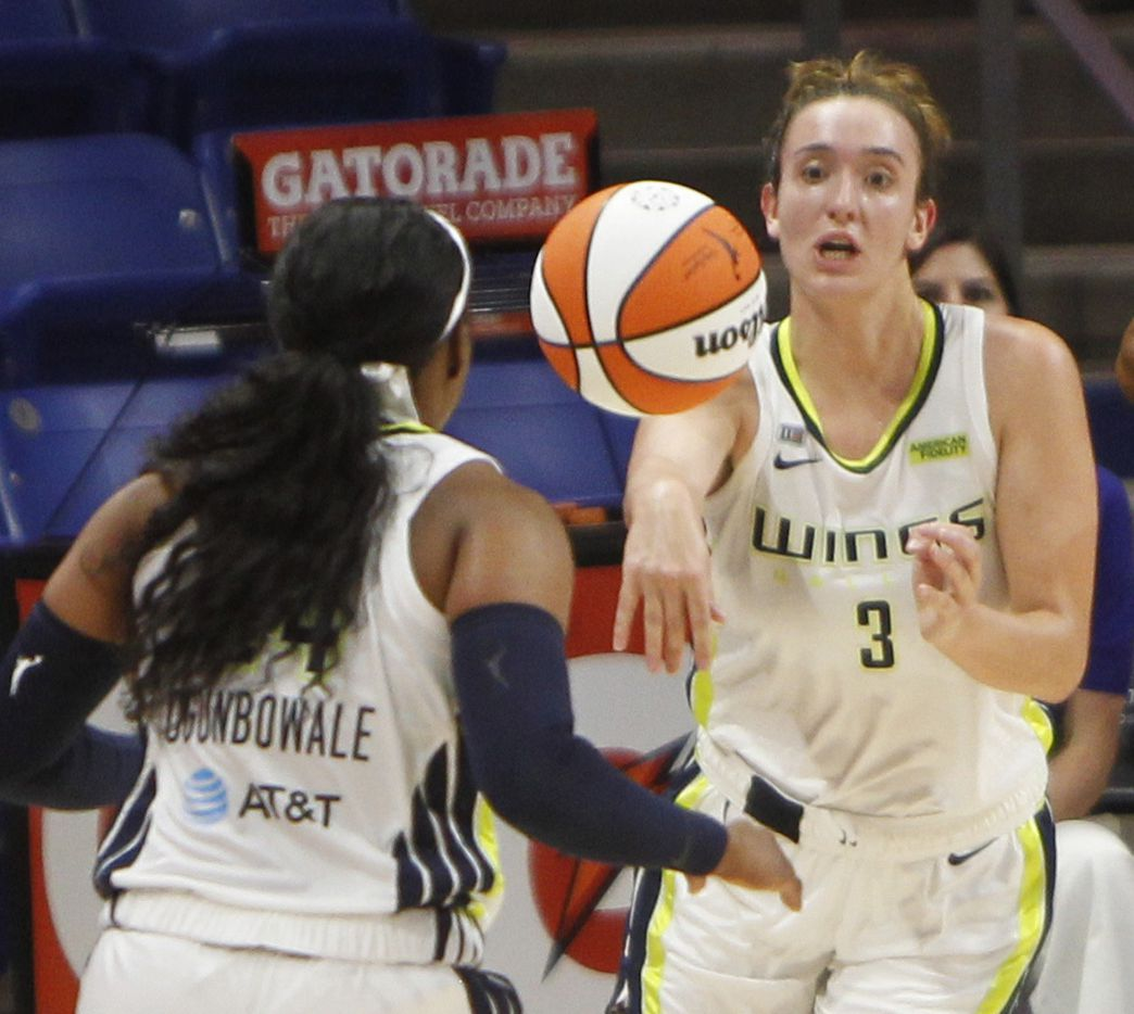 Dallas guard Marina Mabrey (3) gets off an outlet pass to guard Arike Ogunbowale (24) during first half action against Phoenix. The Dallas Wings hosted the Phoenix Mercury for their WNBA game held at UTA's College Park Center in Arlington on May 29, 2021.