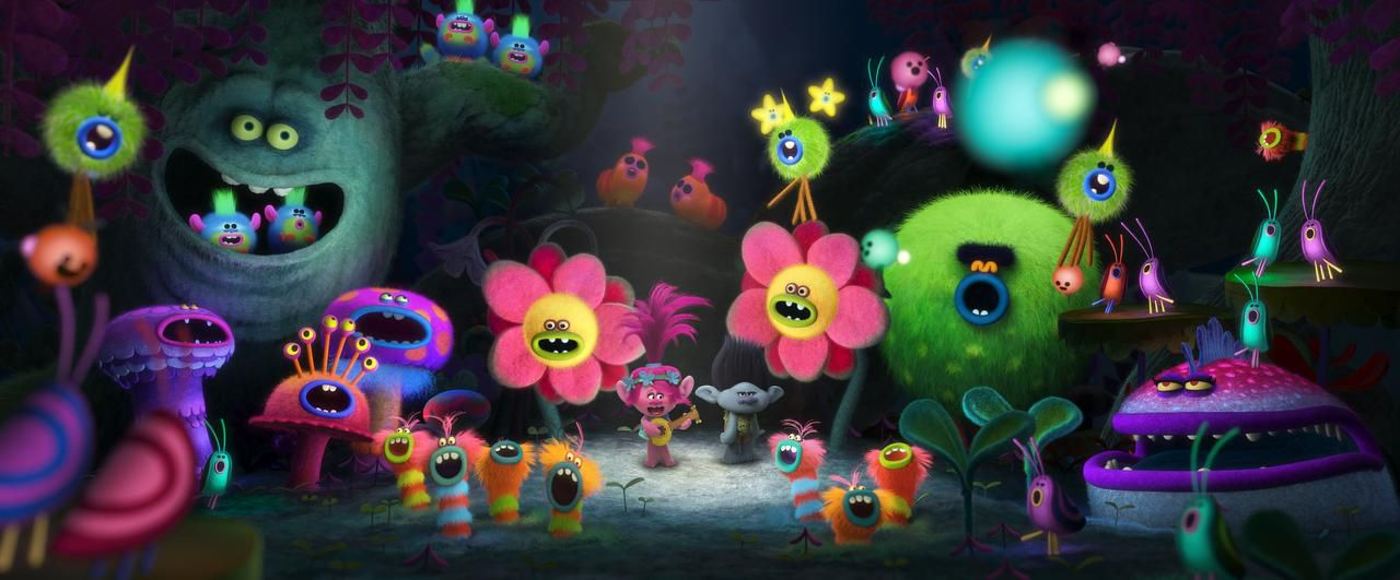 """Poppy (al centro con una guitarra) es la protagonista de """"Trolls"""". La voz de su personaje pertenece a la actriz Anna Kendrock.(DREAMWORKS)"""