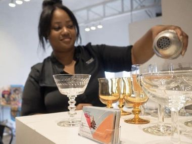 Kim Hunter of Potent Pours makes a cocktail.