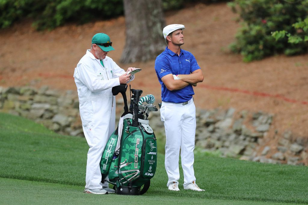 AUGUSTA, GEORGIA - APRIL 14: Bryson DeChambeau of the United States stands with caddie Tim Tucker during the final round of the Masters at Augusta National Golf Club on April 14, 2019 in Augusta, Georgia. (Photo by David Cannon/Getty Images)