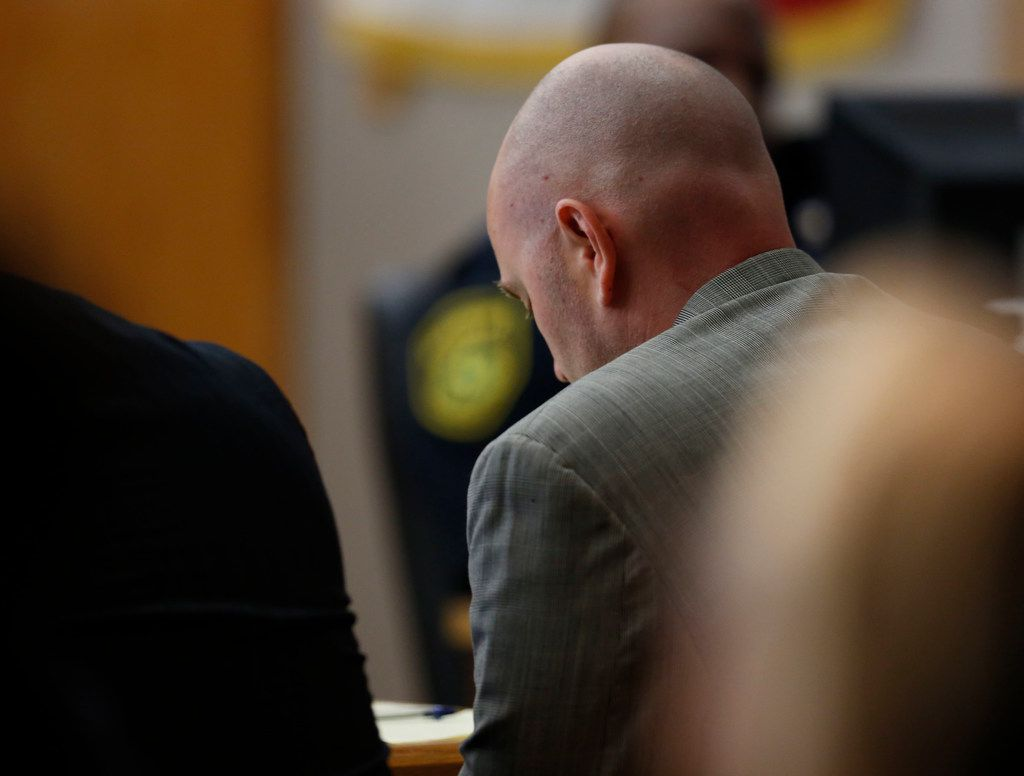 Fired Balch Springs police officer Roy Oliver lowers his head while his mother testified Wednesday at the Frank Crowley Courts Building in Dallas. (Rose Baca/Staff Photographer)