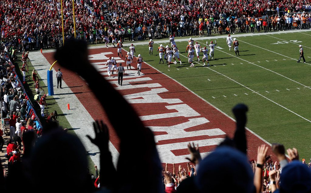 Oklahoma Sooners fans celebrate as Oklahoma Sooners scores on their opening drive against the Texas Longhorns during the first half of play in the Red River Showdown at the Cotton Bowl in Dallas on Saturday, October 12, 2019.
