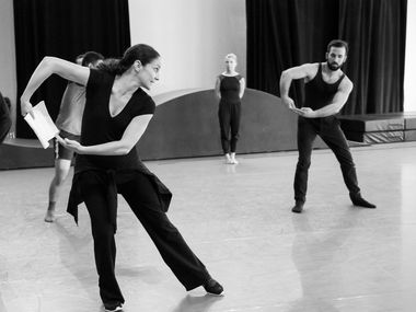 Joy Atkins Bollinger  (left) rehearses the Bruce Wood Dance company, including Olivia Rehrman (center) and Gabriel Speiller (right) for the premiere of her new work, Hillside.
