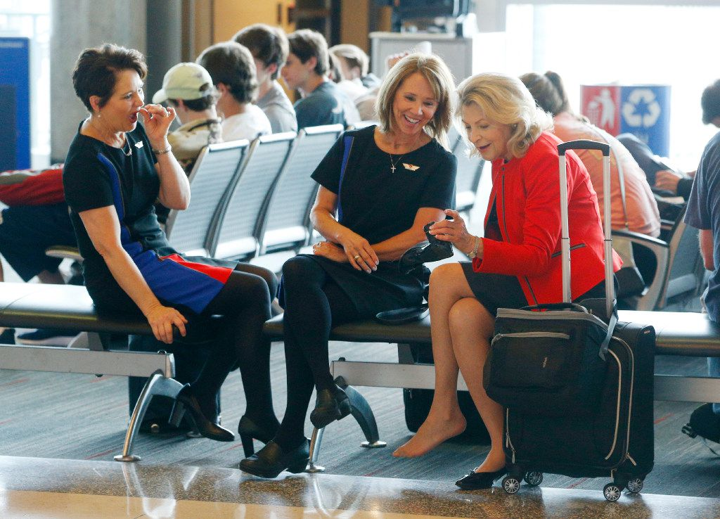 Flight attendants Cheree Hicks, (from left) Shelly Watkins and Sandra Force talk about Sandra's shoes in their new Southwest Airlines uniforms at Dallas Love Field airport in Dallas on June 19, 2017.  (Nathan Hunsinger/The Dallas Morning News)