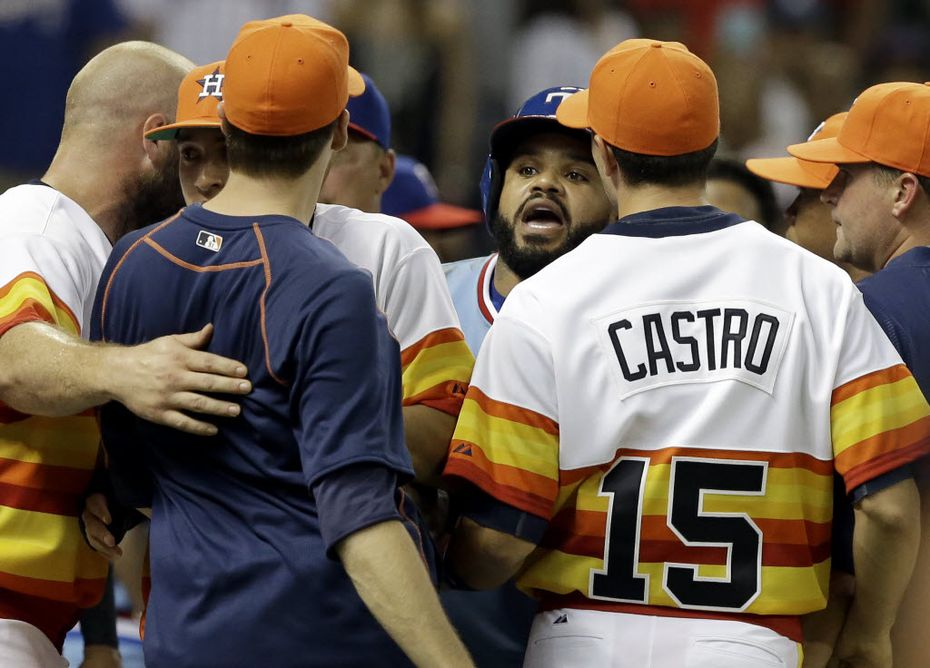 Texas Rangers' Prince Fielder, center, confronts Houston Astros' Jed Lowry, in navy blue, after both benches cleared in the ninth inning of a baseball game Saturday, July 18, 2015, in Houston.  (AP Photo/Pat Sullivan)