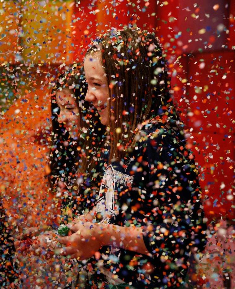 Abigail Corder, 11, (front) and her twin sister Allison Corder play in a cloud of confetti at Candytopia, an immersive pop-up art exhibit, in Dallas on Thursday, April 4, 2019.  (Rose Baca/Staff Photographer)