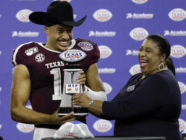 HOUSTON, TEXAS - DECEMBER 27: Kellen Mond #11 of the Texas A&M Aggies receives the MVP trophy as the Texas A&M Aggies defeated the Oklahoma State Cowboys 24-21 during the Academy Sports + Outdoors Texas Bowl at NRG Stadium on December 27, 2019 in Houston, Texas.
