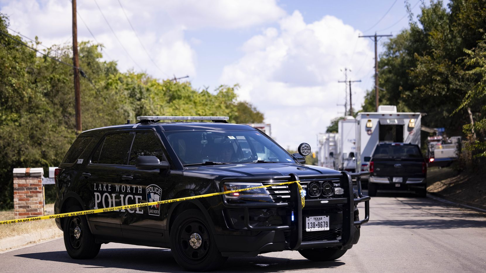 Police blockade close to where a military training aircraft crashed in a residential area on Sunday, Sept. 19, 2021, in Lake Worth. Two pilots were injured and three homes were damages, officials said.