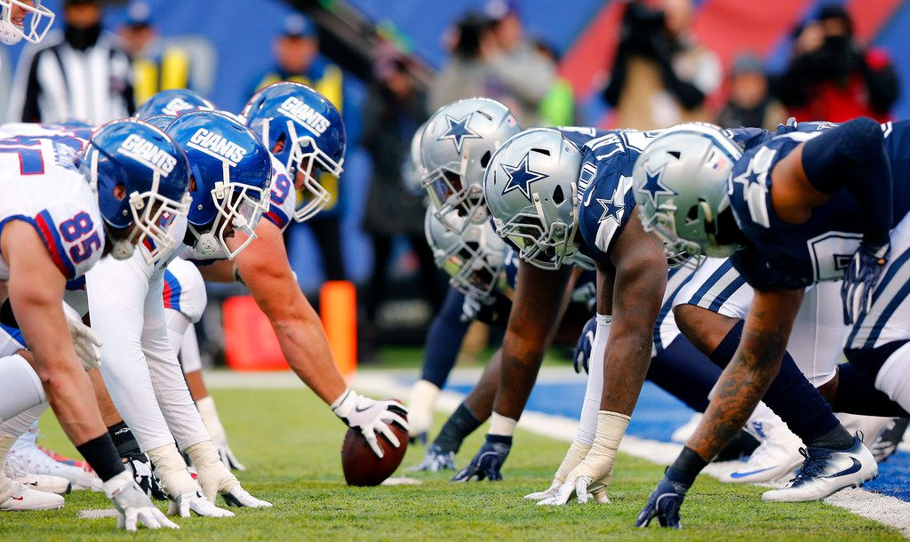 The New York Giants offensive line squares off against the Dallas Cowboys defensive line during the second quarter at MetLife Stadium in East Rutherford, New Jersey, Sunday, December 10, 2017. (Tom Fox/The Dallas Morning News)