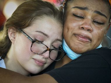 Tears stream down their cheeks as organizers Bela Marcano (left) and Monique Mitchell as they listen to a speaker during a protest organized by a group of Berkner High School students at Berner Park while protests continue after the death of George Floyd on Wednesday, June 3, 2020, in Richardson.