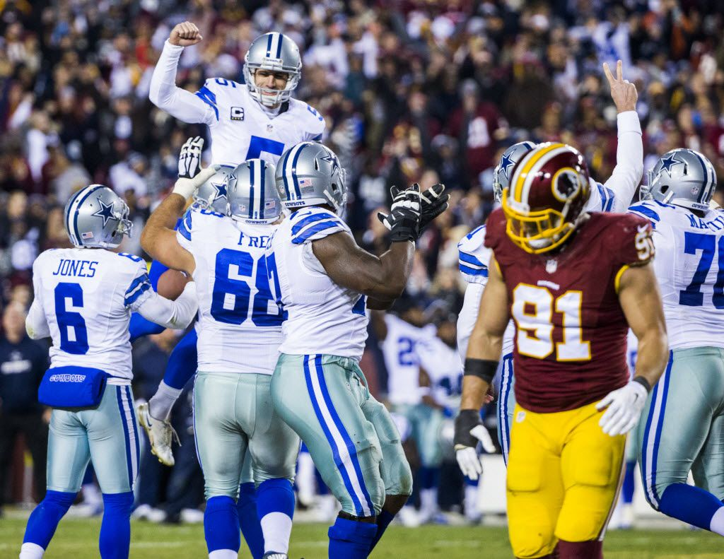 Dallas Cowboys kicker Dan Bailey (5) is lifted up by his team mates after scoring the game winning field goal during the fourth quarter of their game against the Washington Redskins on Monday, December 7, 2015 at FedEx Field in Landover, Maryland.  The Cowboys won 19-16. (Ashley Landis/The Dallas Morning News)